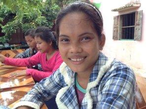 10 secondary school girl smiles -s